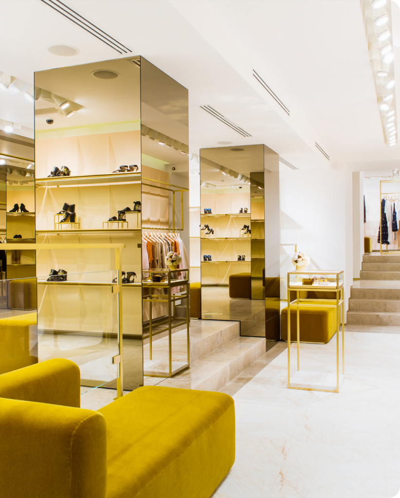 Luxury retail store footwear display with a large yellow couch