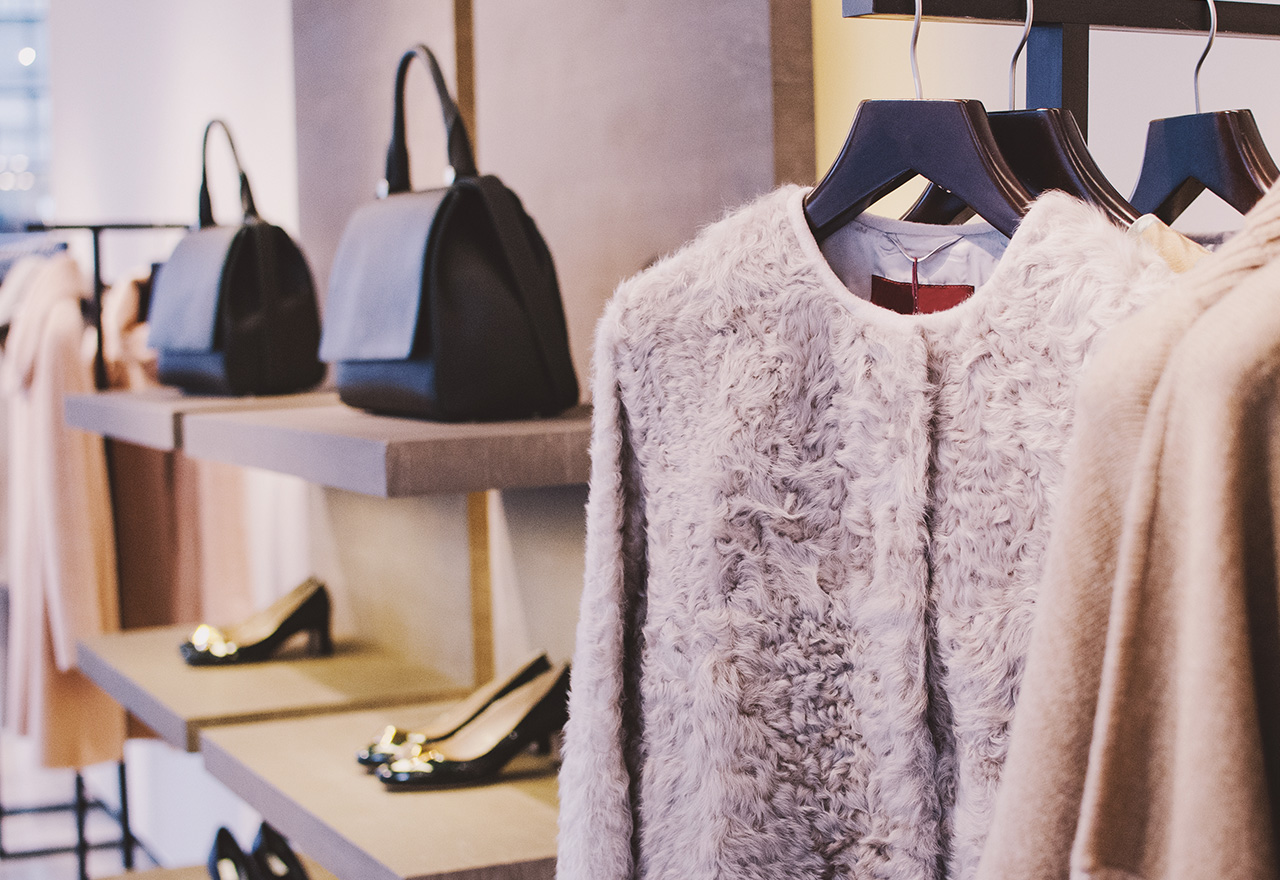 Purses, heels, and mohair sweaters arranged perfectly in a clothing store thanks to a mobile merchandising app