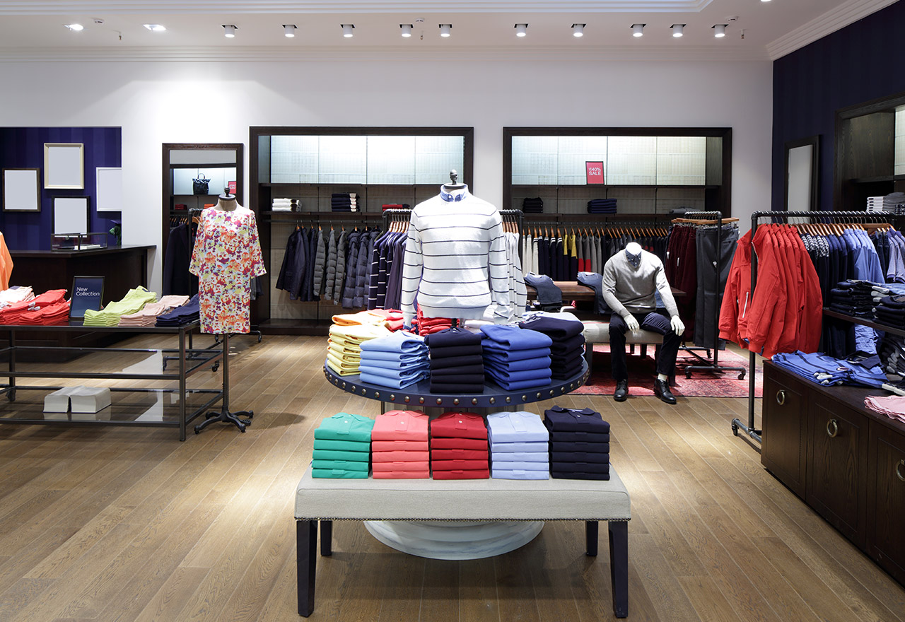 Polos, mannequins, and men's clothing on display after a retail audit