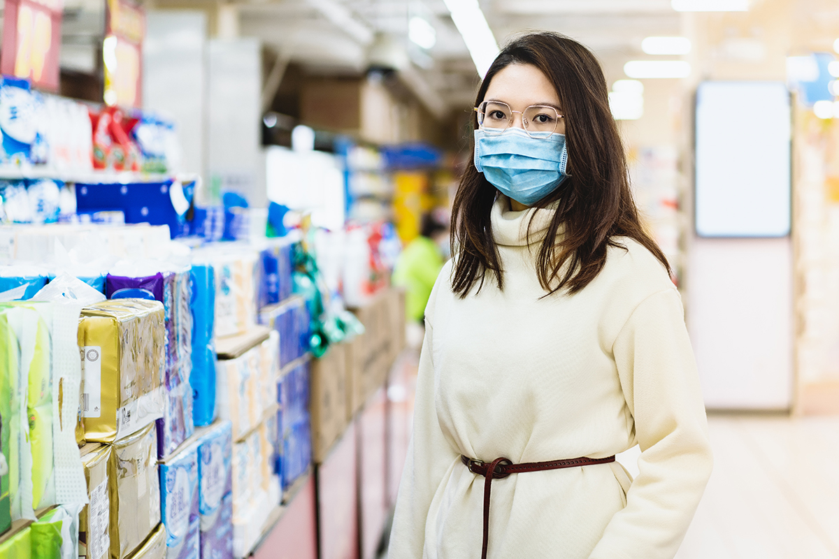 Retail employee with a mask during Covid-19