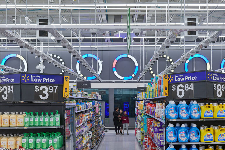 Between two aisles at Walmart, in the laundry product aisle