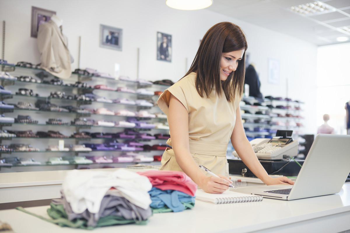 Female retail worker looking at a computer