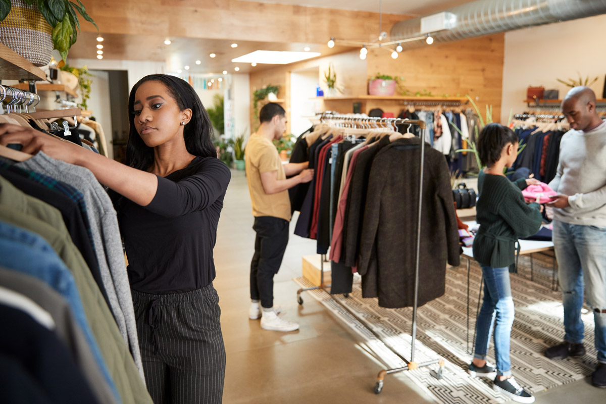 Generation Z retail employees working in a clothing store