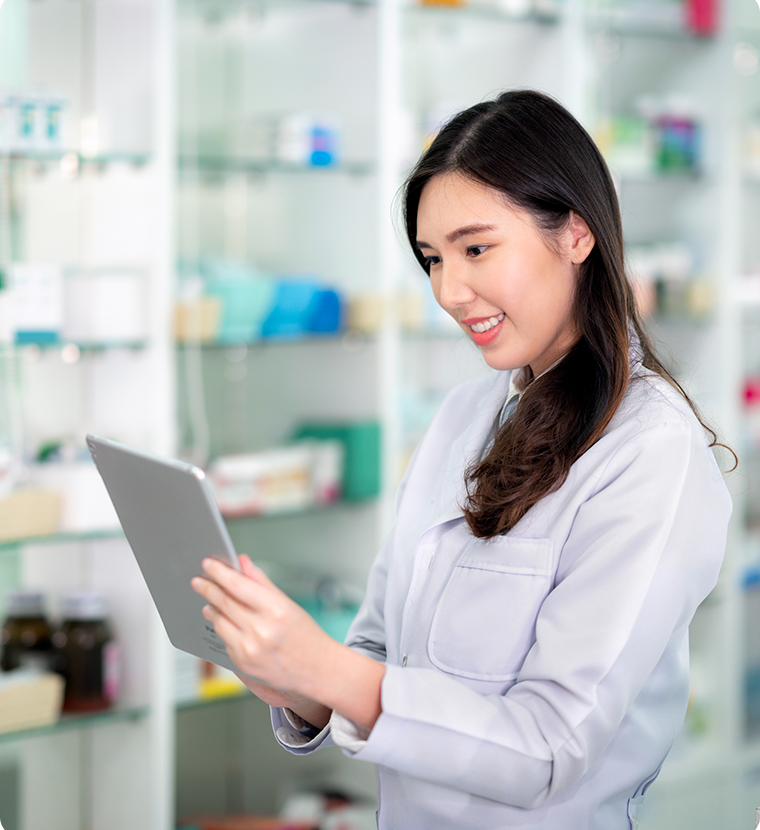 Pharmacy worker holding a tablet