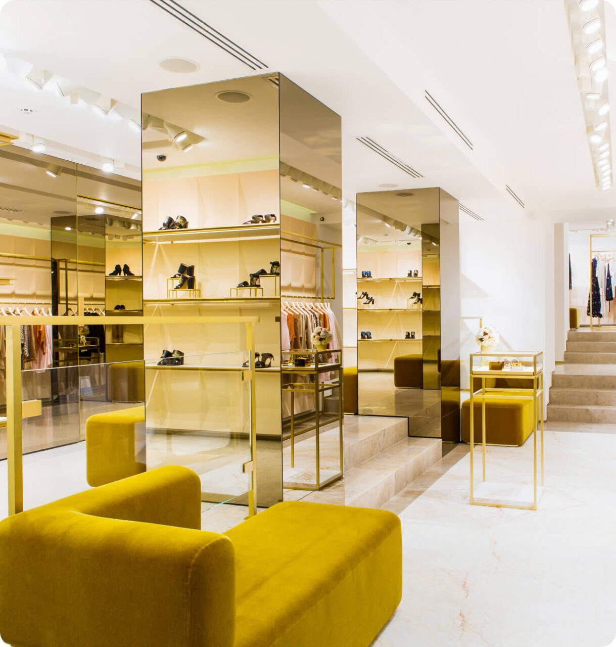 Inside a luxury store with a big yellow couch
