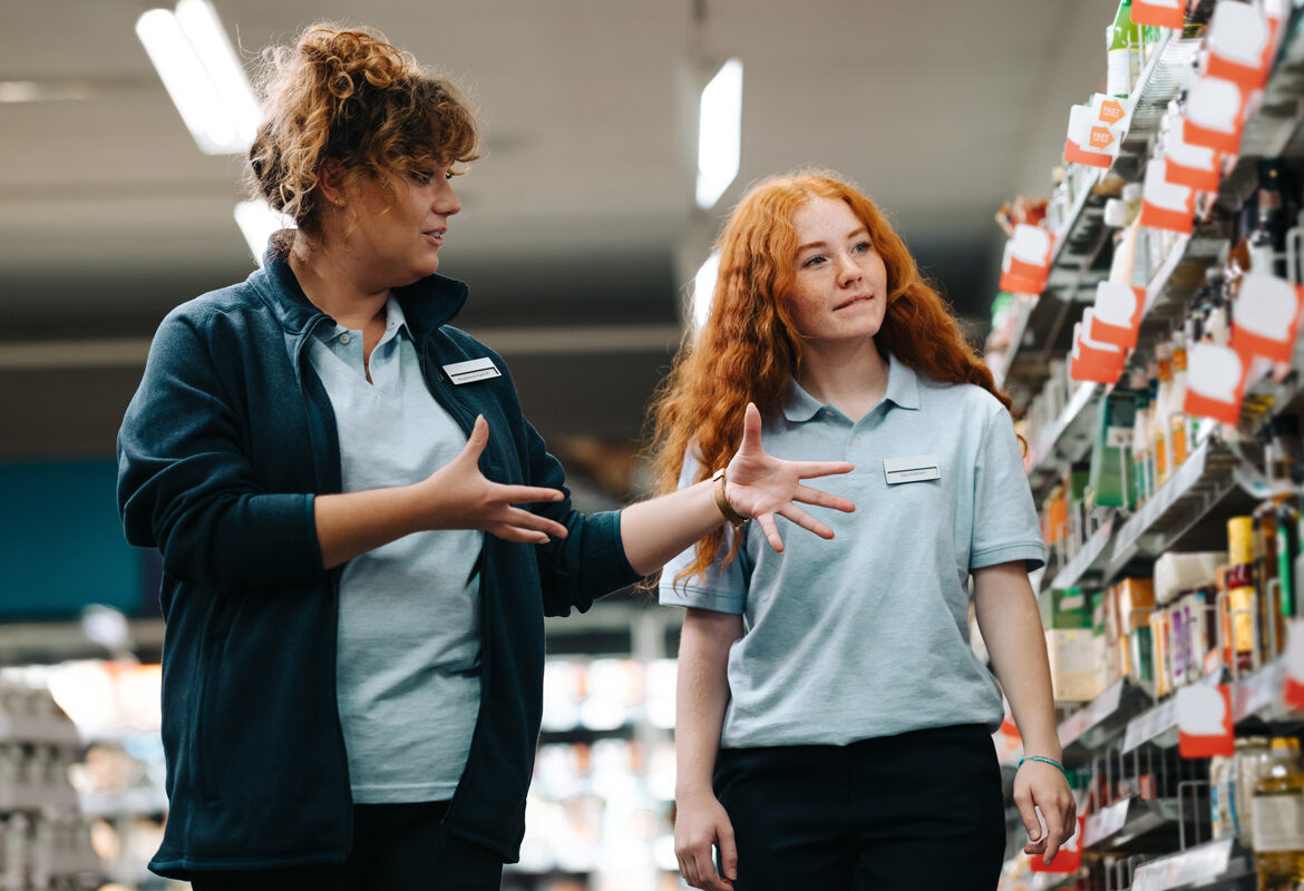 Two retail workers doing a store walkthrough