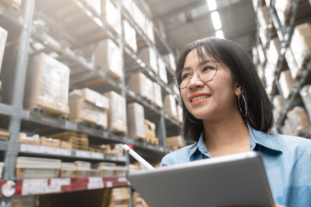 Retail worker holding a tablet while conducting a store audit